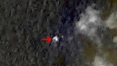 China divulga imagens de possíveis destroços do avião Malaysia Airlines que sumiu no sábado (8)
